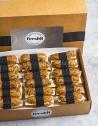 Box de 18 unidades de flautas crujientes hechas con pan burbuja de cereales con tomate, queso Manchego y aceite de oliva virgen.
