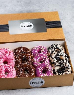 Box de 12 unidades de surtido Fancy MixDots glaseados de cuatro sabores.